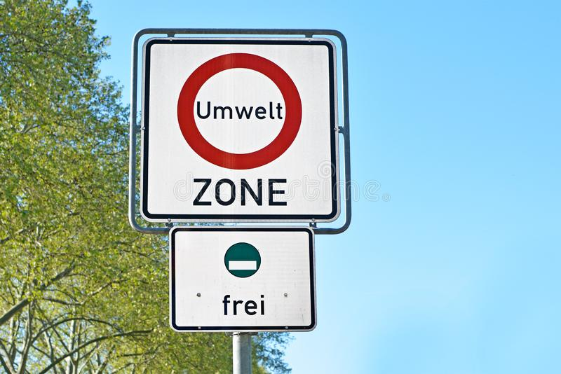 Road traffic sign marking a low emission zone in city centers in Germany. Translating as `Environmental Zone` and sign showing cars with green environmental stock photo