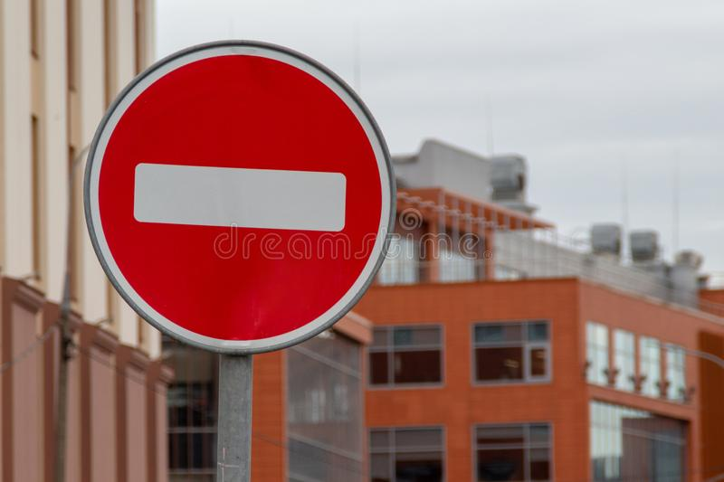 Road traffic sign STOP. Round red white sign at buildings background.  stock images
