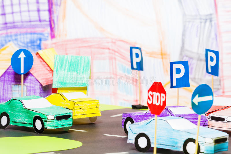 Road traffic in the toy town with handmade cars. Road traffic in the toy town with handmade paper cars and signs model in driving school royalty free stock images