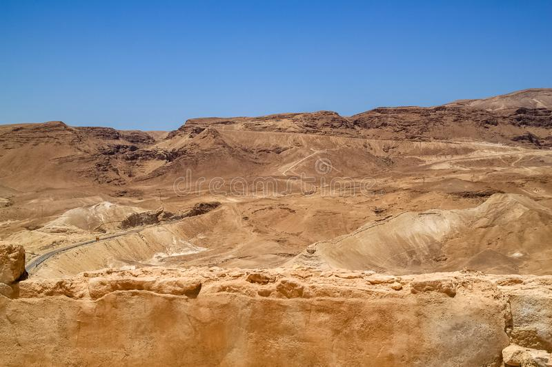 Road travels through the Judean Desert mountains royalty free stock image