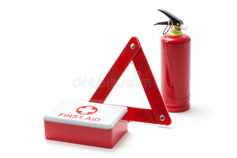 Road Triangle Fire Extinguisher And First Aid Kit. Car equipment - triangle, extinguisher and first aid kit stock image