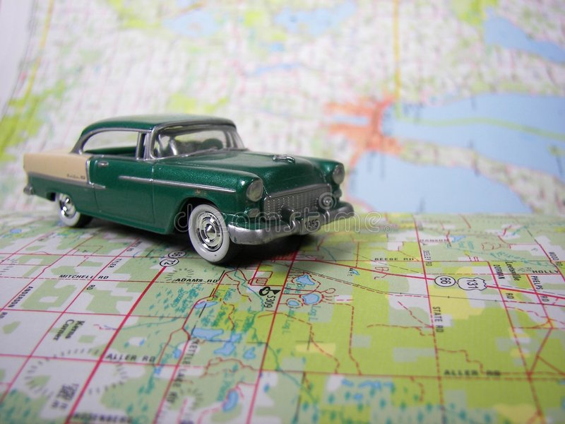 vintage car on road map stock image