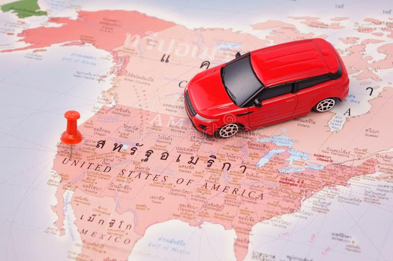 Road trip,car goes on map of the USA stock photography