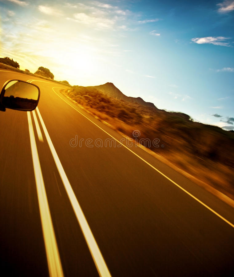 Road trip. Car on the highway, speed drive, road-trip in sunny day, journey and freedom concept, travel and vacation stock photography