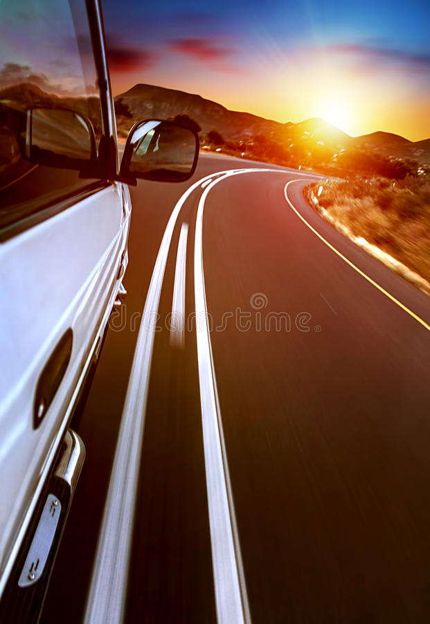 Road trip. Car on the highway,  on sunset, journey and freedom travel, slow motion photo royalty free stock images