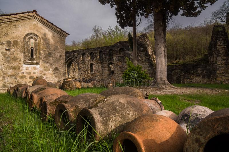 Medieval wine clay jugs in monastery stock photography