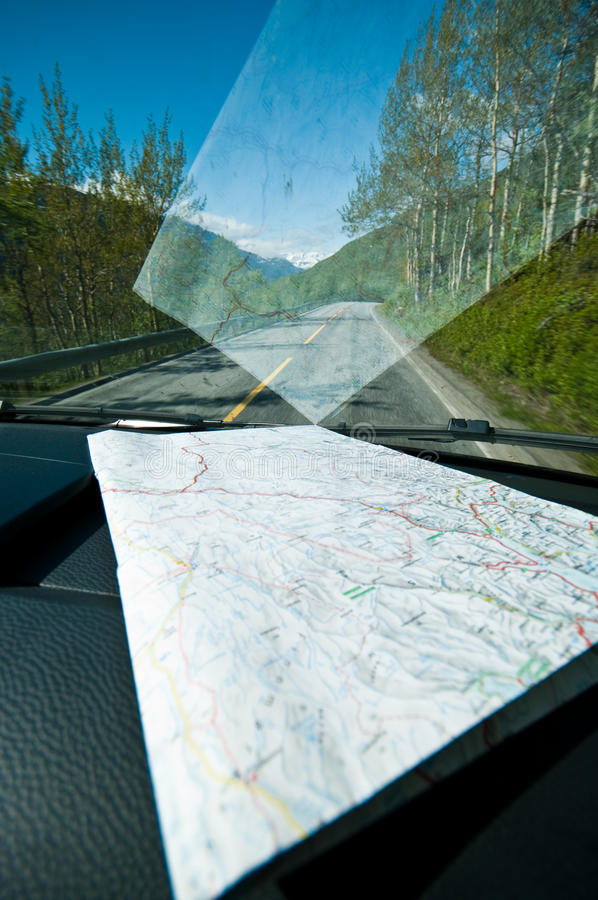 Road trip with map on dashboard stock photos