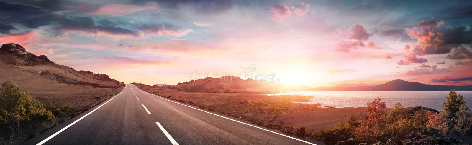 Road Trip - Scenic Landscape With Highway. At Sunrise royalty free stock images