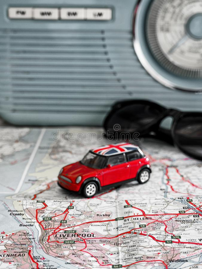 Road trip to Liverpool with red union jack Mini map radio and sunglasses stock photos