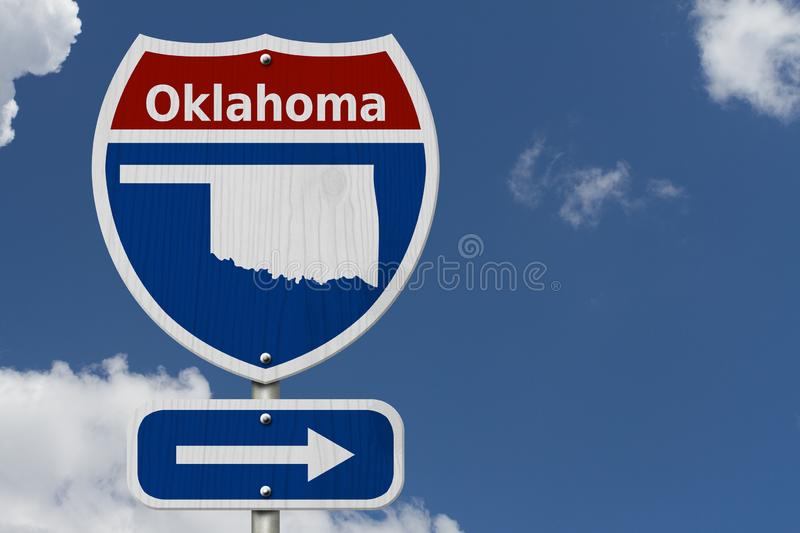 Road trip to Oklahoma sign. Road trip to Oklahoma, Red, white and blue interstate highway road sign with word Oklahoma and map of Oklahoma with sky background royalty free stock photo