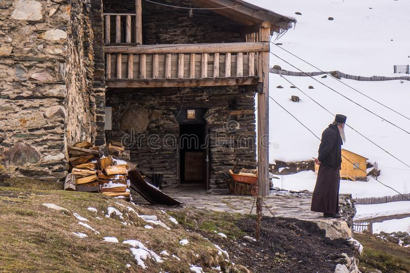 Orthodox priest in front of ushguli chapel stock images