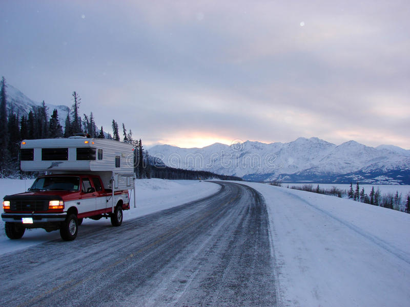 Road Trip in Winter. A short break from driving along the Cassiar Highway in winter leads to this breath taking view of the mountains and snowy landscape stock images