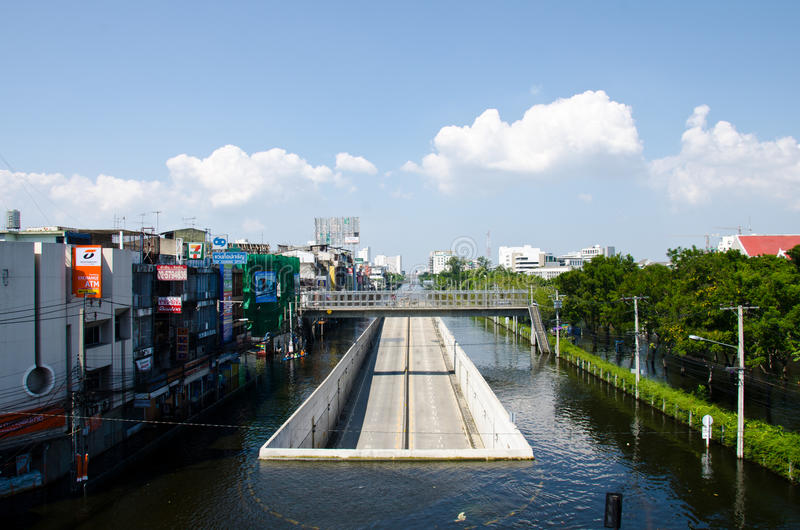 A road tunnel dries and survives from the flooded. BANGKOK - NOVEMBER 13: A road tunnel dries and survives from the flooded area at Kaset - Navamin crossed roads royalty free stock photos