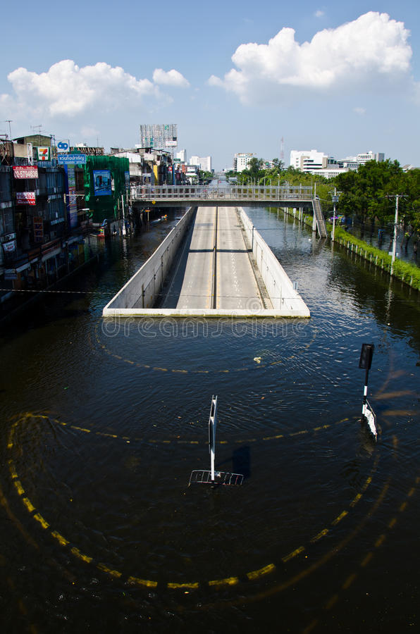 A road tunnel dries and survives from the flooded. BANGKOK - NOVEMBER 13: A road tunnel dries and survives from the flooded area at Kaset - Navamin crossed roads royalty free stock photography