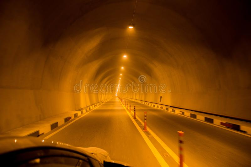 Road tunnel at night view stock photo, highway road tunnel, space for text stock images