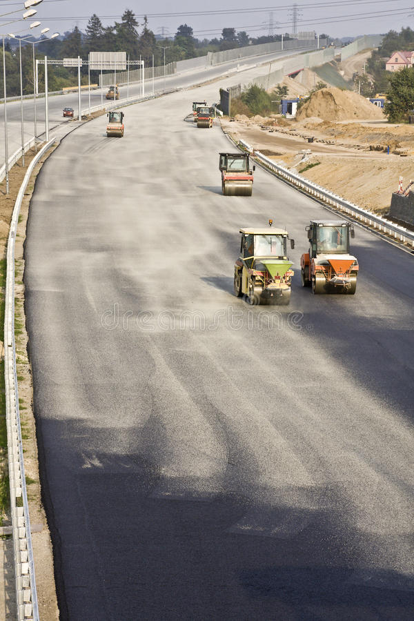 Road under construction. With heavy duty machinery stock image