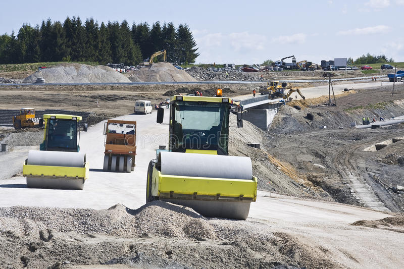 Road under construction. With heavy duty machinery stock photography