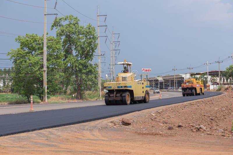 Road under construction, pneumatic tyred roller paver at asphalt. NAKHON RATCHASIMA -MAY 2 : road under construction, pneumatic tyred roller paver at asphalt stock photos