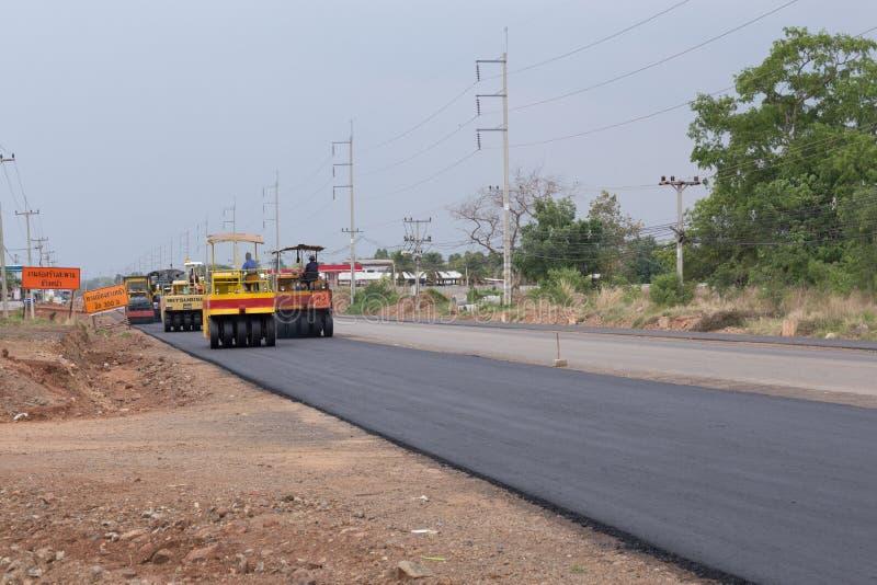 Road under construction, pneumatic tyred roller paver at asphalt. NAKHON RATCHASIMA -MAY 2 : road under construction, pneumatic tyred roller paver at asphalt stock images