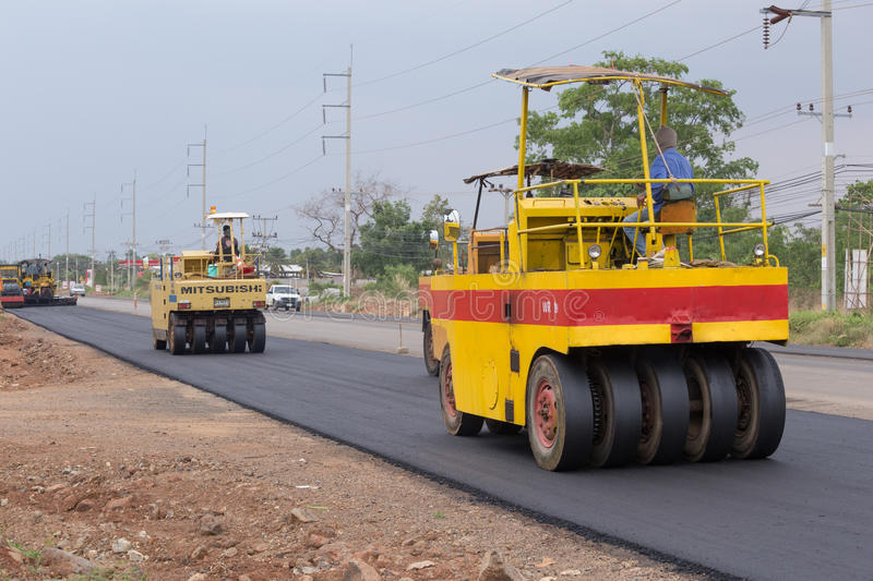 Road under construction, pneumatic tyred roller paver at asphalt. NAKHON RATCHASIMA -MAY 2 : road under construction, pneumatic tyred roller paver at asphalt royalty free stock photography