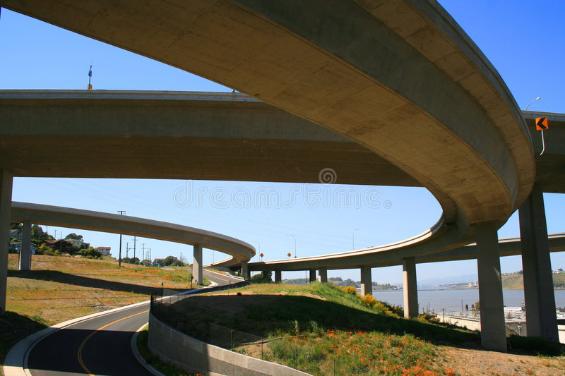 Road Under the Freeway Ramps. Close up of a road under the freeway ramps stock photos