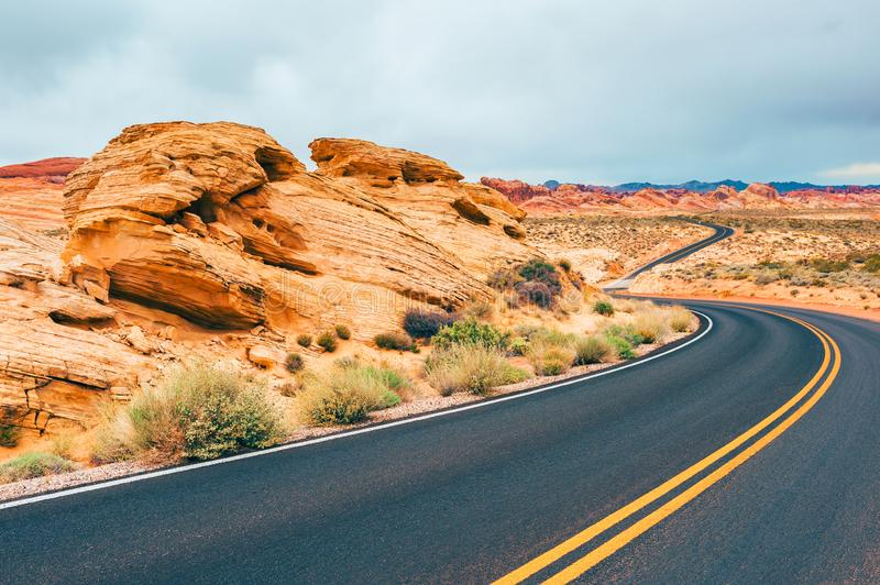 Road through Valley of Fire State Park Nevada USA. Road through Valley of Fire State Park, Nevada, USA royalty free stock images