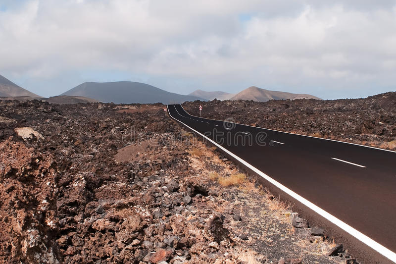 Download Road in volcanic scenery. stock photo. Image of vacation - 12525672