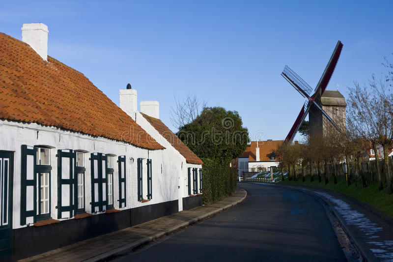 Road and a windmill, Belgium stock image