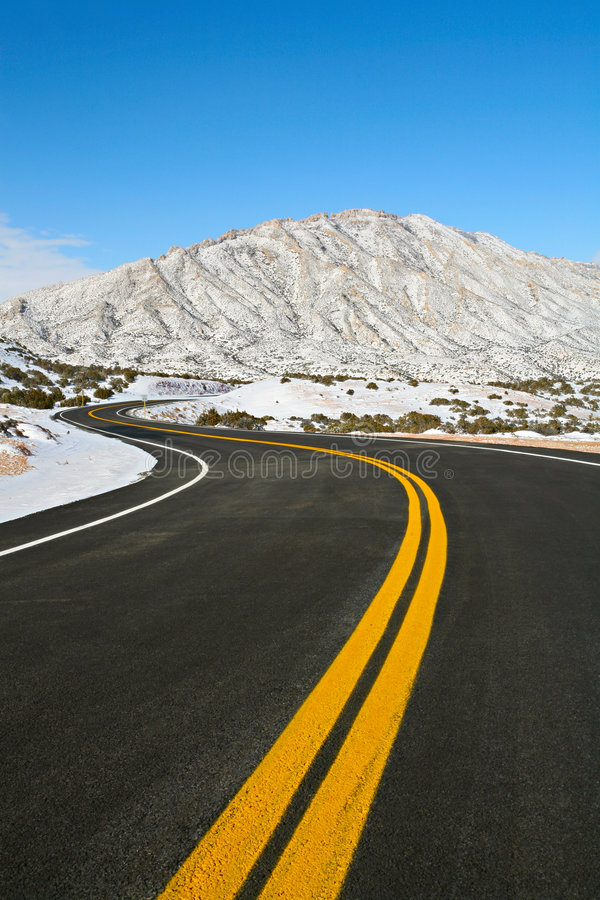 Road through winter mountains royalty free stock photography