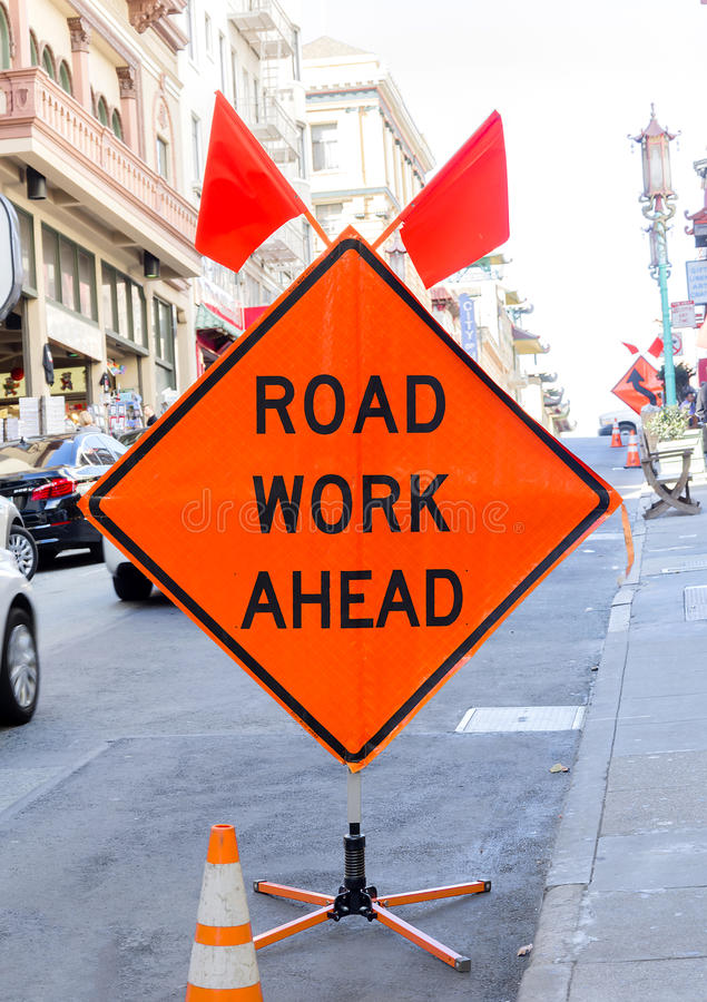Road work ahead. Orange sign on the street stock image
