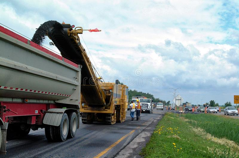 Road work with an asphalt road milling machine royalty free stock photo
