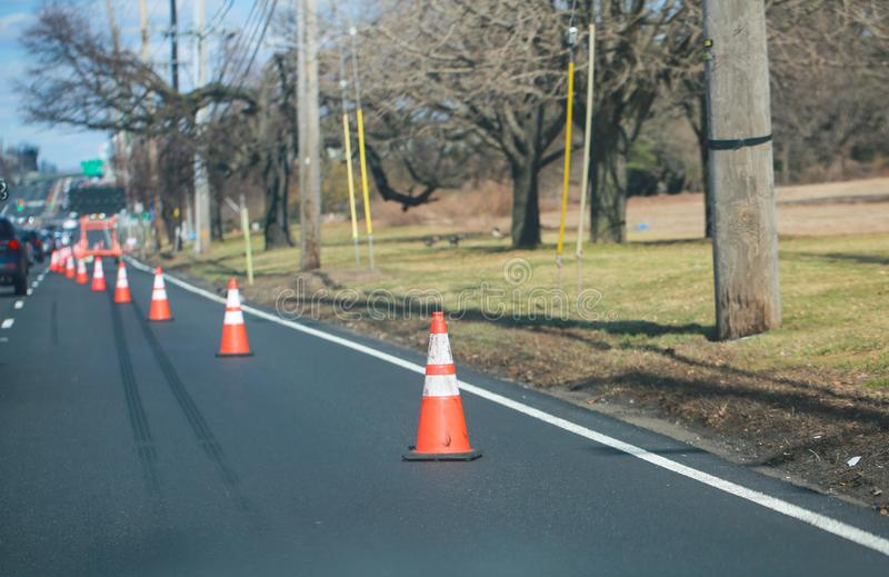 Road work. Orange traffic cones in the  street. Princeton, New Jersey, USA, March 16 2019:Road work. Orange traffic cones in the  street. - Image royalty free stock photos