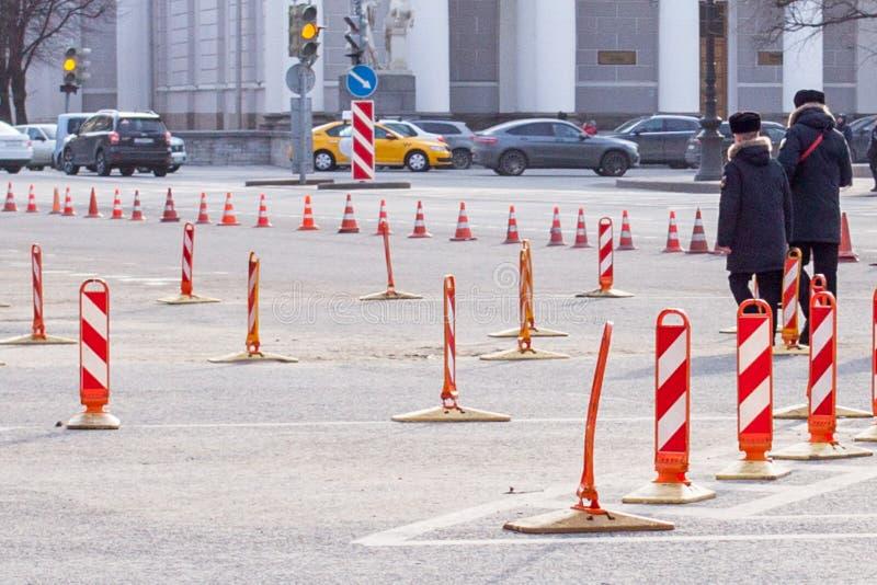 Road work signs Orange traffic cones. Road work. Orange traffic cones in the middle of the street. traffic safety construction roadwork signs. Walking people stock image