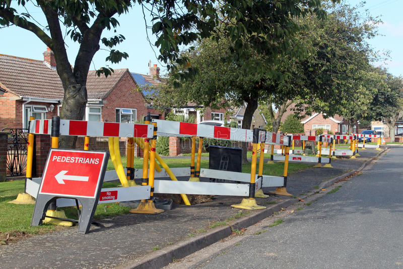 Road work warning signs and barriers. Road work warning signs and barriers in a street in England royalty free stock images