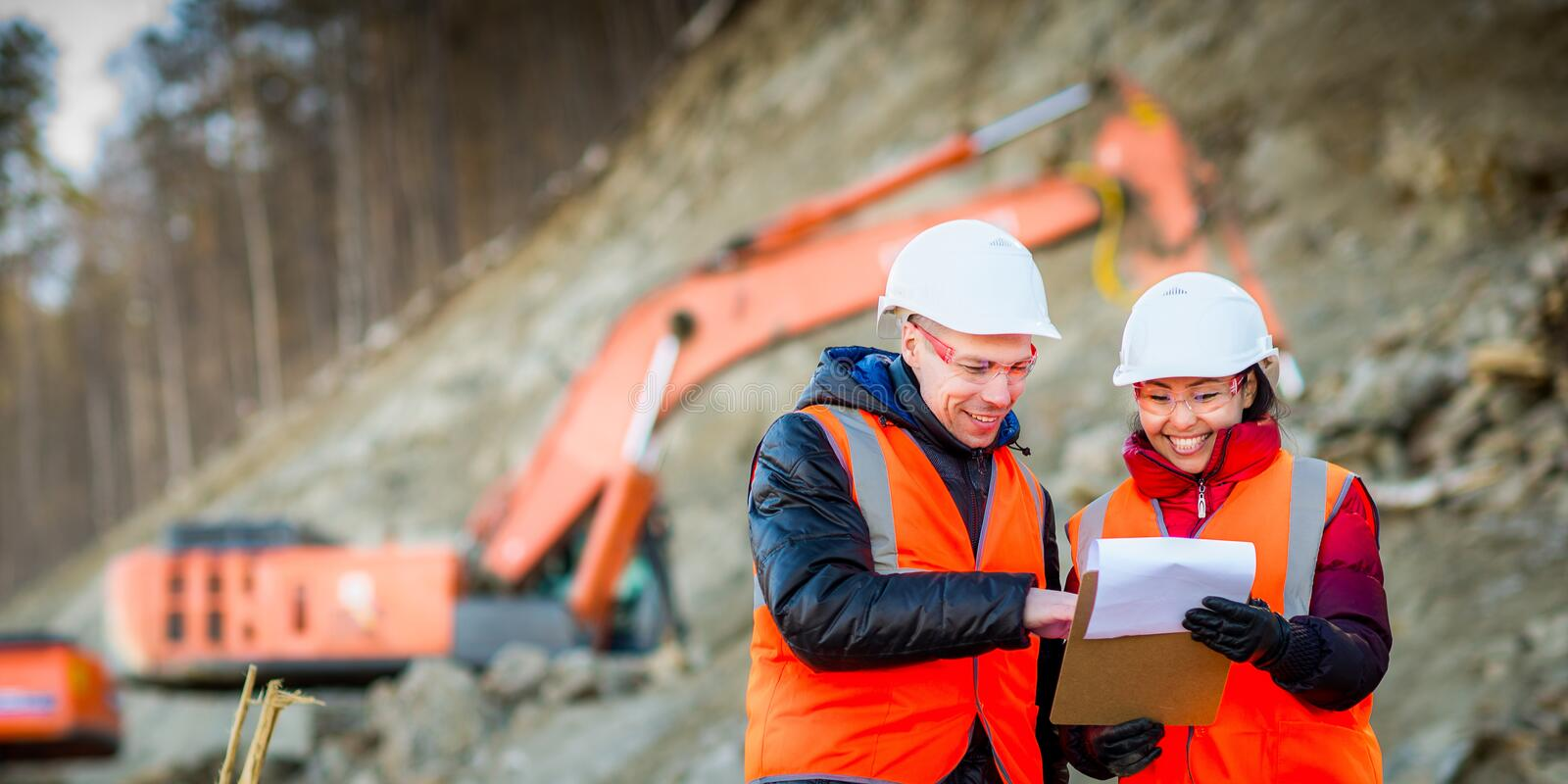 Road workers inspecting construction stock photography
