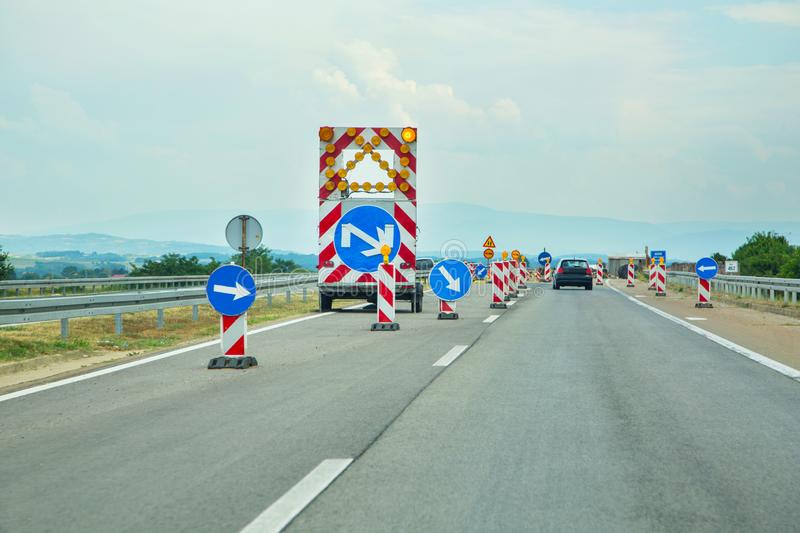 Road works construction hinders traffic in a highway stock photos