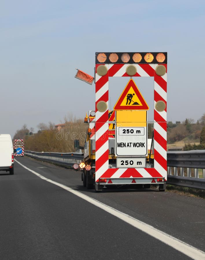 road works on the motorway without worker and the text MEN AT WO royalty free stock photo