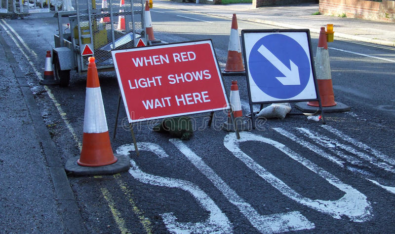 Download Road Works With When Red Light Shows Wait Here Sig Stock Photo - Image of construction, amber: 36663202