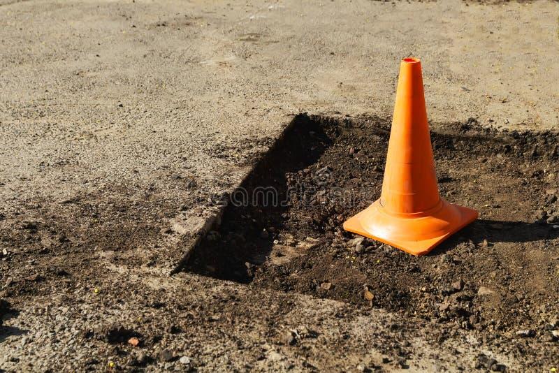 Road works repair. Road sign repair in road pit stock photos