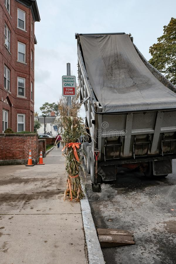 Dumper truck seen dumping tarmac in Salem, MA. Road works seen in progress on the side road of this famous US town, famous for the witch trials. Halloween style royalty free stock photo
