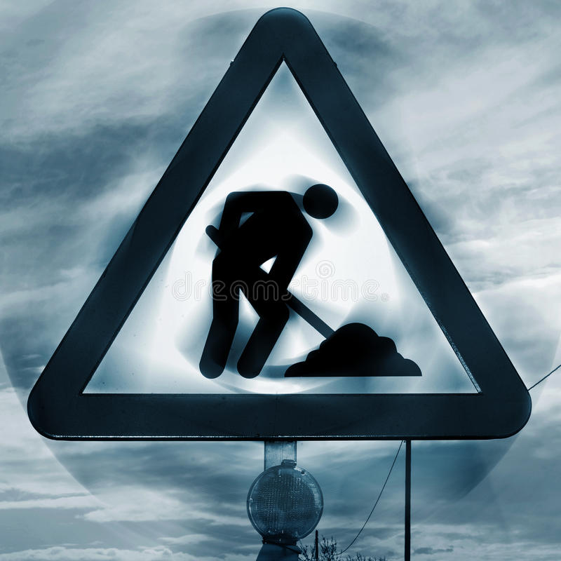 Road works sign. A road works sign in a road under construction stock photos