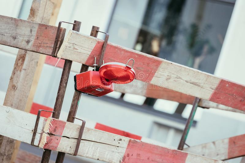Road works: signal and warning lamps, urban city. Road works with signal or warning lamp, summer time traffic delay highway repair street travel barrier urban stock image
