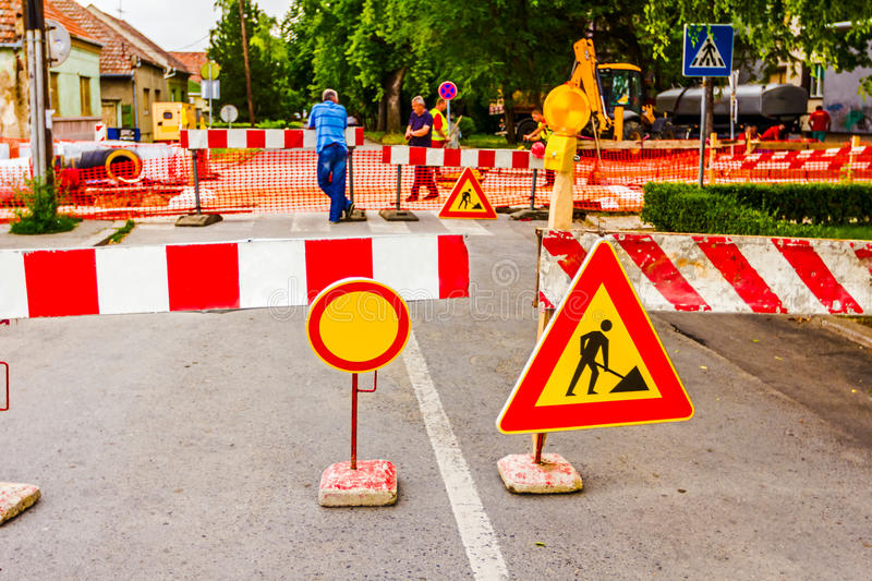 Road works. Road signs in a street, under reconstruction symbol stock image