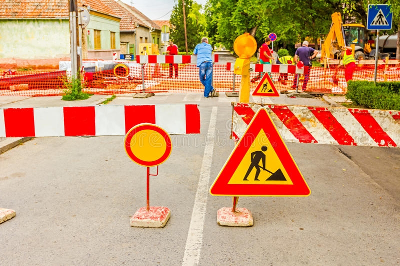 Road works. Road signs in a street, under reconstruction symbol royalty free stock photo