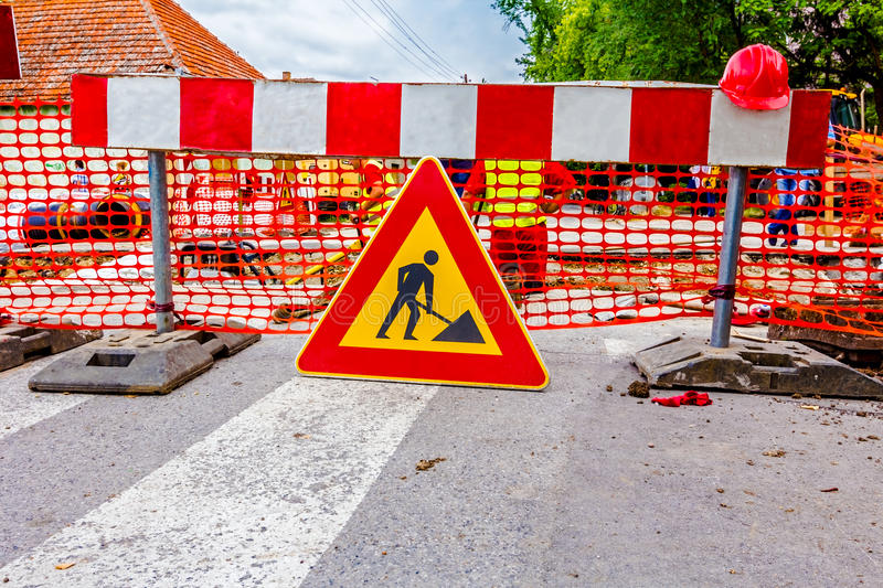 Road works. Road signs in a street, under reconstruction symbol royalty free stock photography