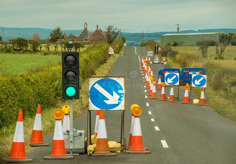 Road Works. Traffic lights and signage on a country road to control around road works royalty free stock images