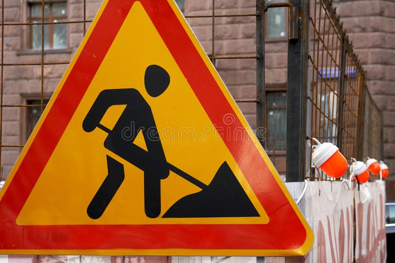 Road works traffic sign on the Moscow street in front of a repairing area. With warning lights on the Moscow street royalty free stock image