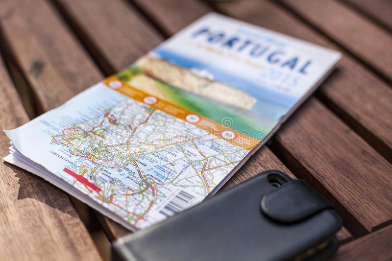 Roadmap. Of Portugal on a terrace table, a cel phone next to it royalty free stock photos