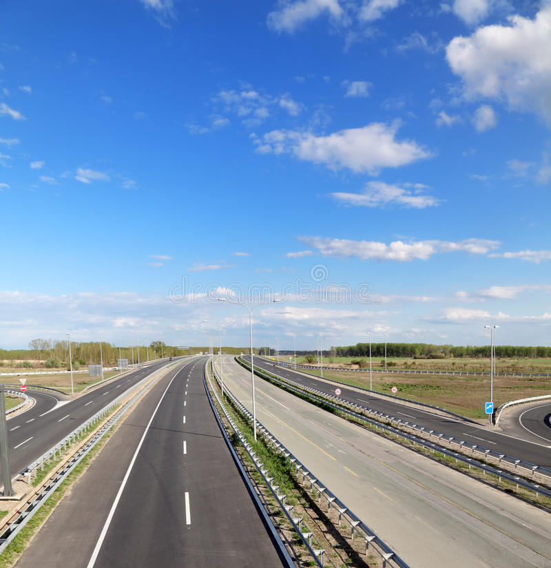 Roads. New and old highway with blue sky in perspective royalty free stock images