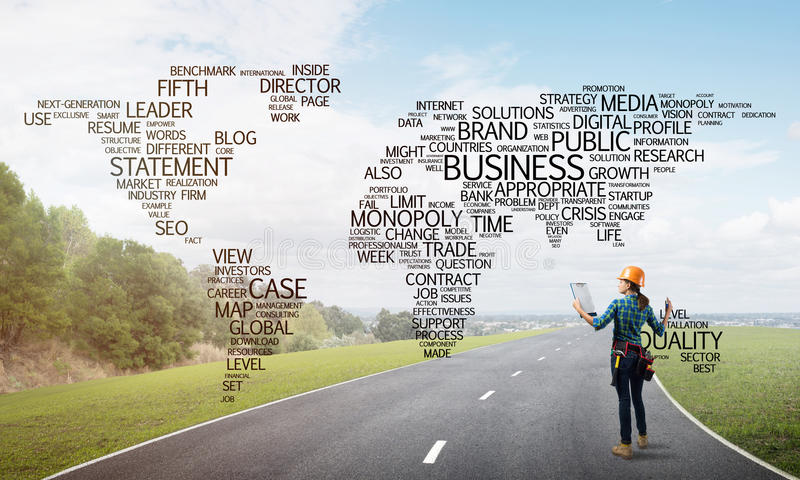 Roads connect the world. Female construction worker on road and globalisation concept stock photography